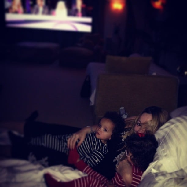 """Mariah Carey snuggled with her """"junior judges"""" during an airing of American Idol one night. Source: Instagram user mariahcarey"""