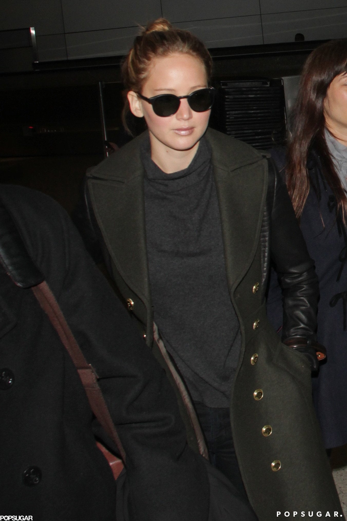 Jennifer Lawrence wore her sunglasses after landing in LA.