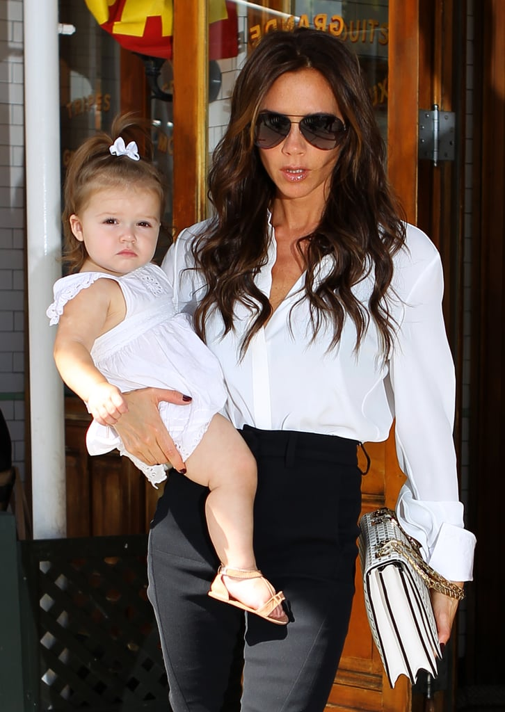 Mother and daughter matched in white leaving Pastis restaurant in NYC in Sept. 2012.