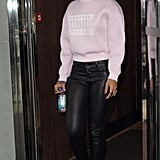 "While cruising around London, Rihanna donned a coveted, fresh off-the-runway ""parental advisory"" Alexander Wang sweater shirt with coated J Brand skinnies and white pumps."