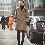 A classic coat met cool-girl booties for an understated effect. Source: Le 21ème | Adam Katz Sinding