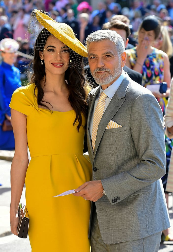 George and Amal Clooney were among the select group of celebrities who received a special invite to Prince Harry and Meghan Markle's royal wedding on Saturday. Just weeks after turning heads at the Met Gala in NYC, the couple made their way across the pond, where they arrived in style at St. George's Chapel at Windsor Castle to witness Harry and Meghan officially become husband and wife. George cut a suave figure in a light gray suit, while Amal looked like a ray of sunshine in a yellow ensemble. Unfortunately, they didn't bring their twins, Alexander and Ella, but the little ones will be celebrating their very first birthday on June 6.       Related:                                                                                                           17 Times George and Amal Clooney Looked Madly in Love