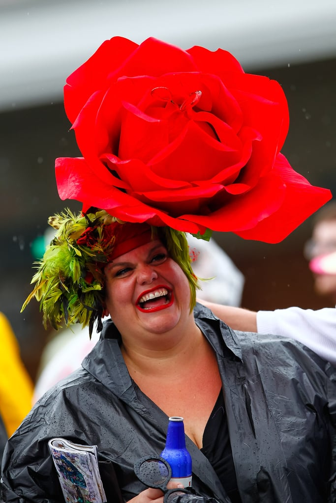 I take it back. Now, that's a lot of red! Even in the rain this woman was all smiles in her huge red-flower hat in 2013.