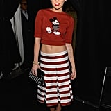 Miley rocked a striped skirt and cropped Mickey Mouse sweater from Marc Jacobs's Spring collection with Jean-Michel Cazabat pumps and a Jacquie Aiche body chain for MJ's Fall 2013 show during NYFW.