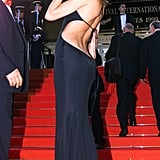 Before she was the first lady of France, Carla Bruni attended the film festival as an actress in 1999, wearing a revealing black gown with an open back.