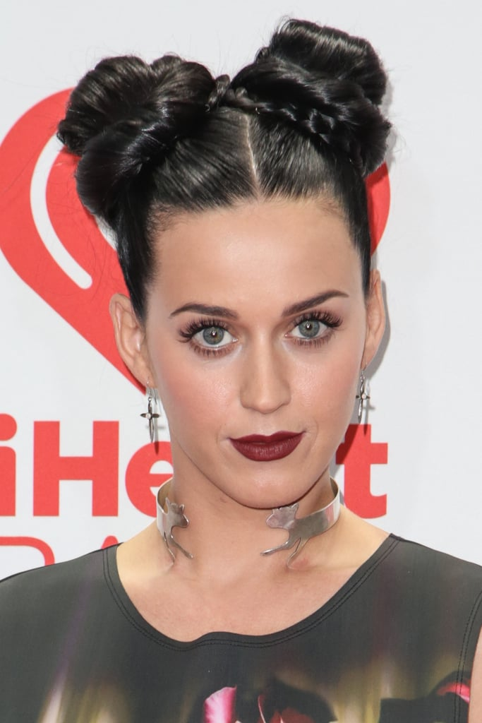 With her double topknots, reptilian necklace, and brick-red lipstick, Katy Perry made a bold statement on the iHeartRadio Music Festival red carpet.