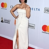 Wearing a strapless white gown with buttons to Clive Davis's Grammy party.