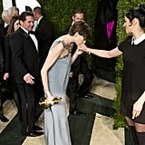 Anne Hathaway kissed Sarah Silverman's hand on the red carpet at the Vanity Fair Oscar party.