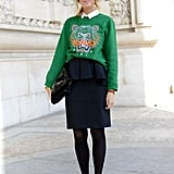Her Kenzo sweatshirt gave that pencil skirt sporty appeal.