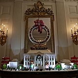 A gingerbread rendering of the White House in the State Dining Room is an annual tradition. This year's consists of 150 pounds of gingerbread on the inside, 100 pounds of bread dough on the outside frame, 20 pounds of gum paste, 20 pounds of icing, and 20 pounds of sculpted sugar pieces.