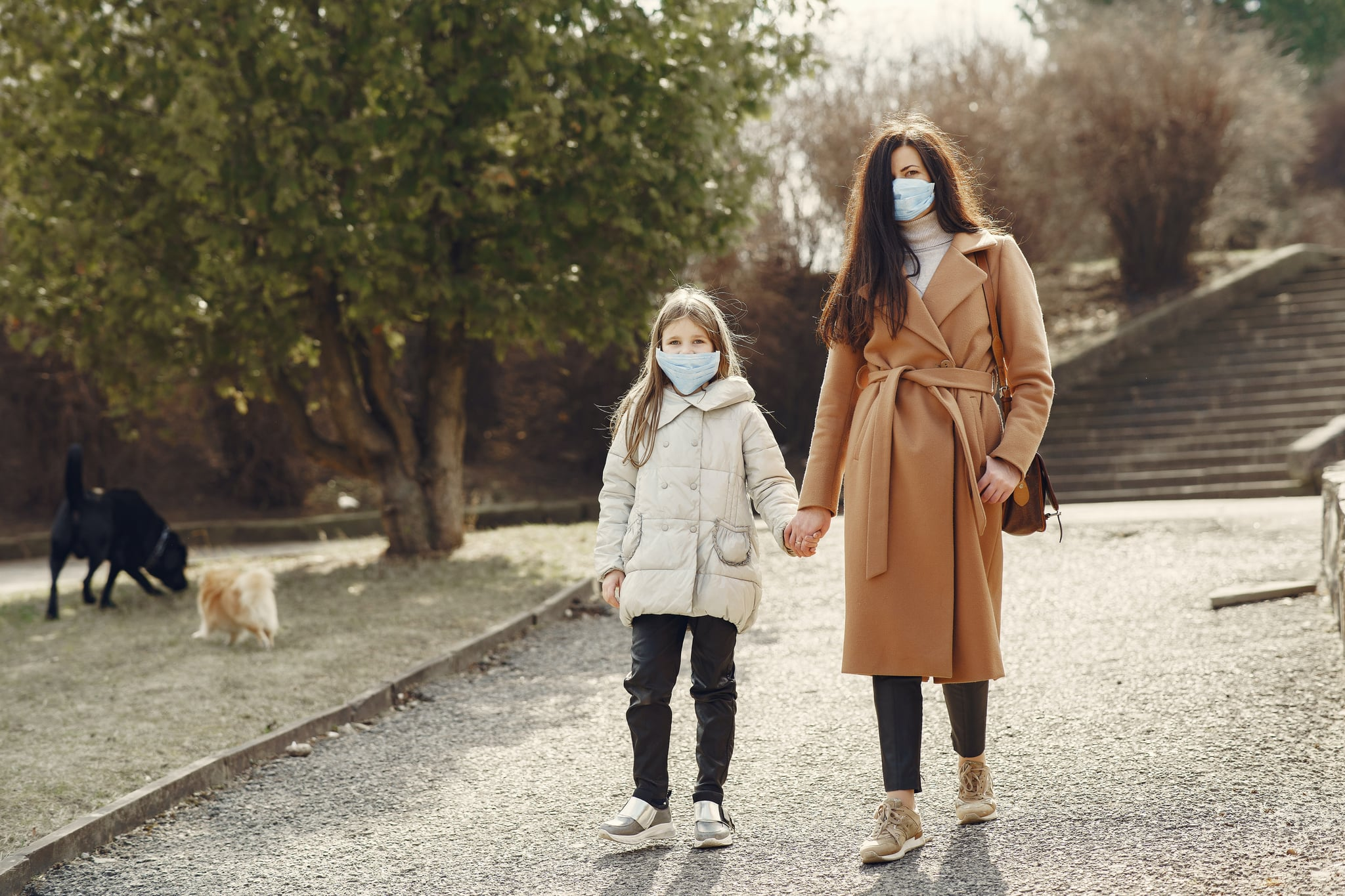 tmp_od7hiO_b20b9718d619358a_mother-with-daughter-in-face-masks-walking-in-park-4000622.jpg