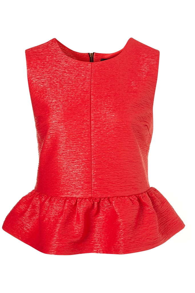 Bright red was spotted all over the street during Milan Fashion Week. Take the trend stateside in this textured top with a slight sheen. Let its subtle details — and bold color — shine by pairing it with slick black cigarette pants.  Topshop Textured Peplum Top ($60)