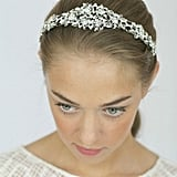 Made with vintage-inspired crystals, rhinestones, and pearls, this piece is definitely a statement bridal headband ($75).