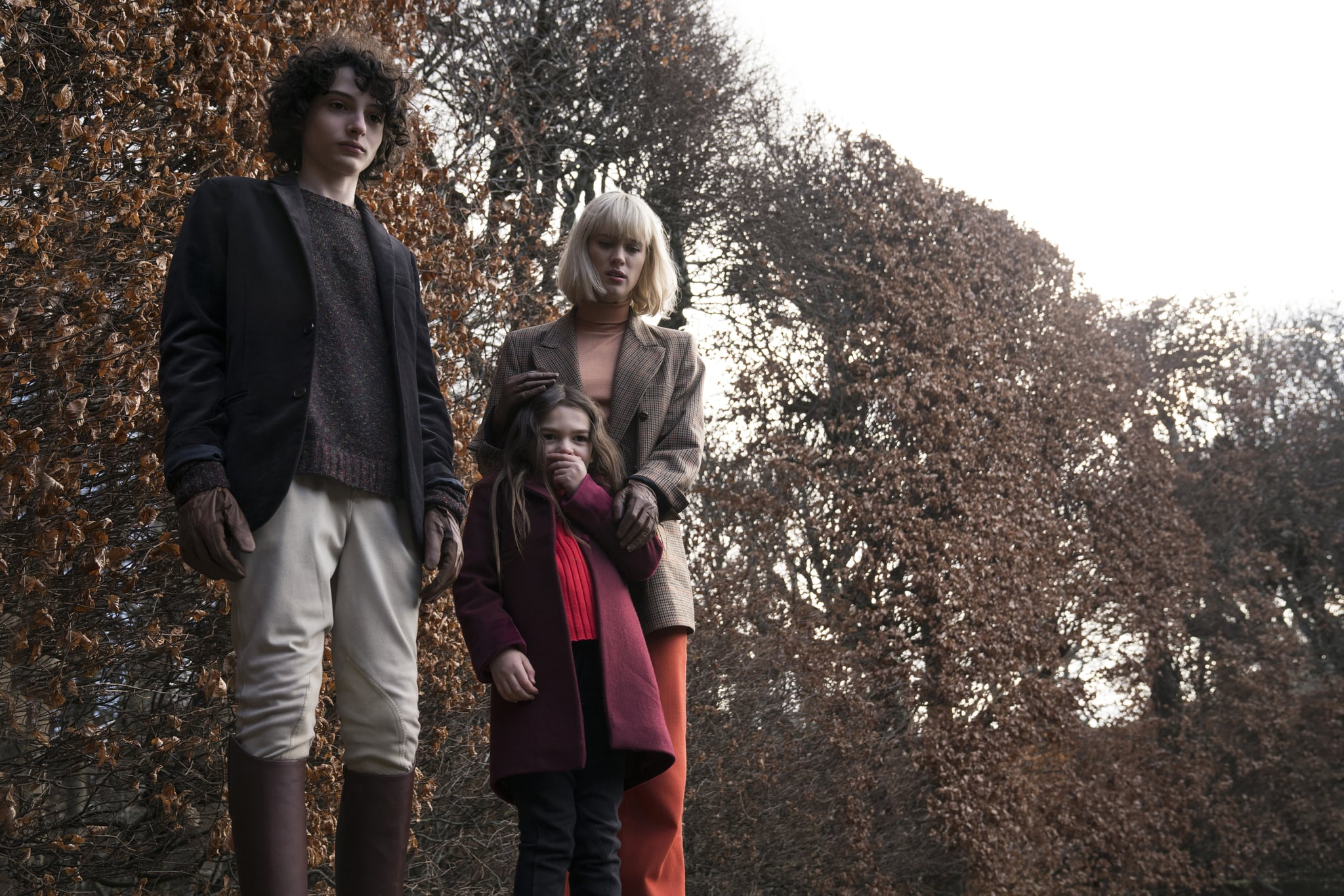 (from left) Miles Fairchild (Finn Wolfhard), Flora Fairchild (Brooklynn Prince) and Kate Mandell (Mackenzie Davis) in