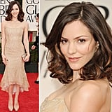 Her time on American Idol may be long gone, but Katharine McPhee is still a golden girl. The lovely chanteuse has opted for a Donna Karan embellished corset gown of layered gold tissue, complemented with champagne-hued platform pumps.
