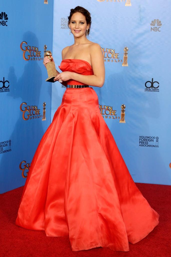 Jennifer Lawrence showed off her Golden Globe Award in the press room.