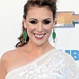 Smoky eyeliner and an oversize bouffant were the highlights of Alyssa Milano's look.