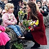 Kate received flowers from a young girl when she visited the Caerphilly Family Intervention Team in February in Caerphilly, Wales.