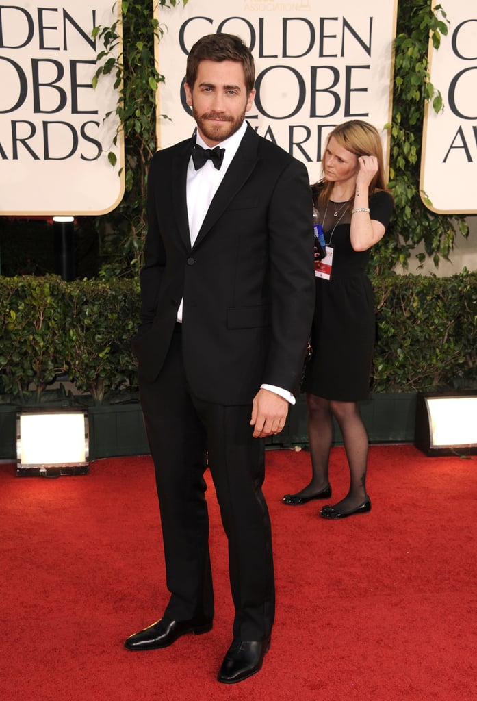 Jake Gyllenhaal was too cute last night on the red carpet at the Golden Globes. The actor was decked out in a simple tux for the event, just like on Saturday when he made the rounds at the Art of Elysium Heaven Gala. He shared space on the carpet with his Love and Other Drugs costar Anne Hathaway, who was showing some skin in Armani!
