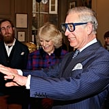 Prince Charles tried on a pair of goggles as his wife, Camilla, Duchess of Cornwall, chuckled during a visit to the Art Worker's Guild in London on Thursday.