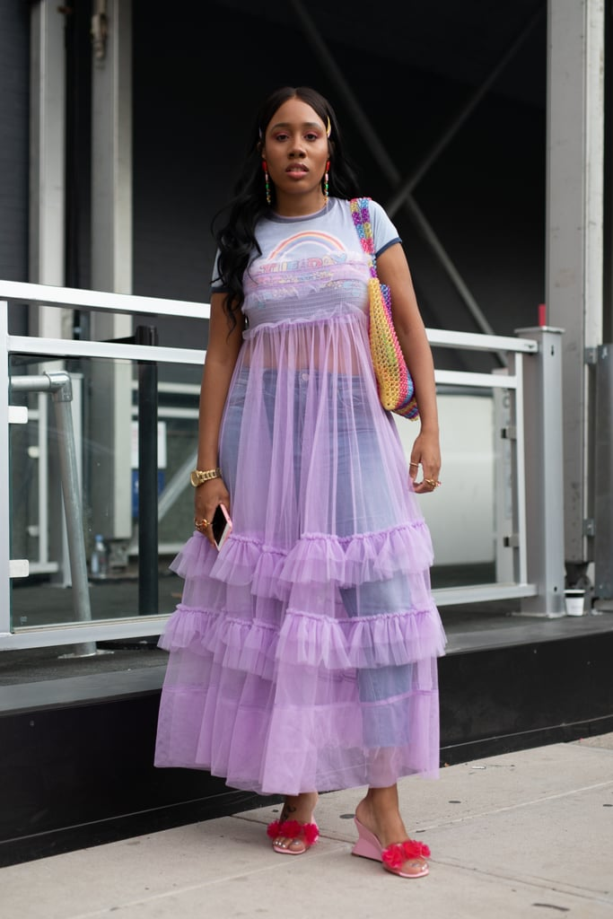 Styling a purple sheer dress with jeans underneath.