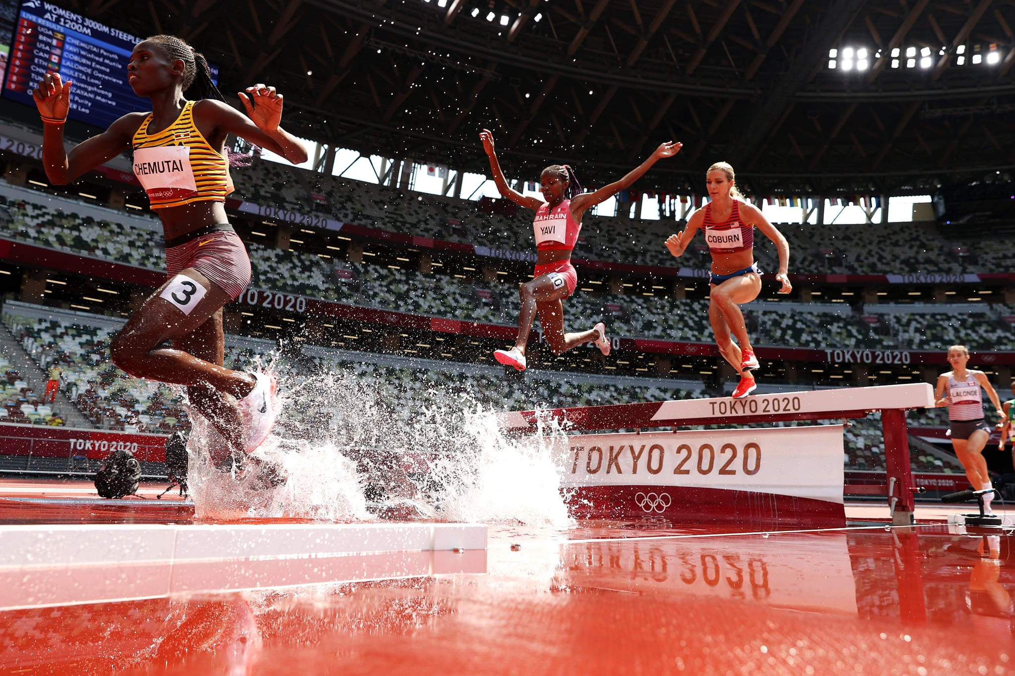 TOKYO, JAPAN - AUGUST 01:  Peruth Chemutai of Team Uganda, Winfred Mutile Yavi of Team Bahrain and Emma Coburn of Team United States compete in round one of the Women's 3000m Steeplechase heats on day nine of the Tokyo 2020 Olympic Games at Olympic Stadium on August 01, 2021 in Tokyo, Japan. (Photo by Christian Petersen/Getty Images)