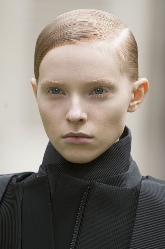 The male and female models had similar looks on the Rad Hourani catwalk. Both wore extreme side parts with slicked-back sides.