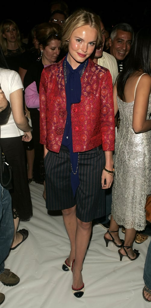 Kate styled a borrowed-from-the-boys look with a cropped brocade jacket, navy tie-neck blouse, and striped Bermuda shorts at the Spring 2005 Marc Jacobs show during New York Fashion Week.