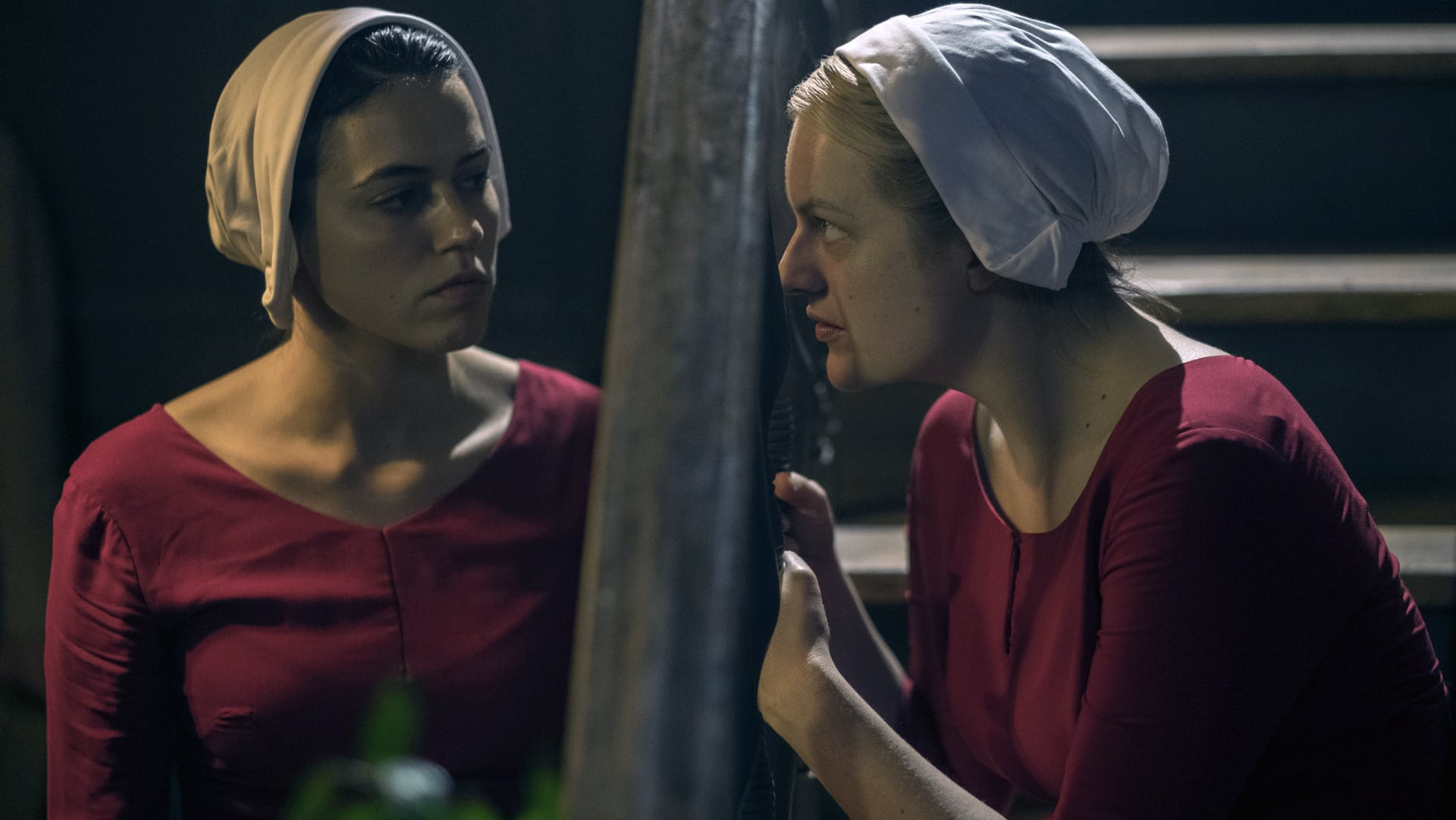 THE HANDMAID'S TALE, l-r: Nina Kiri, Elisabeth Moss in 'Other Women' (Season 2, Episode 4, aired May 9, 2018). ph: George Kraychyk/ Hulu/courtesy Everett Collection