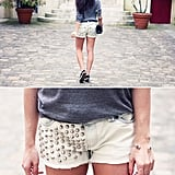An ultra-embellished piece, like these silver-studded shorts, instantly soups up the edginess of the Chucks-and-gray-sweater combination. Photo courtesy of Lookbook.nu