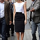 Kate Beckinsale perfected the black and white ensemble in London, wearing a pencil skirt and crop top combo. Her success lies in the details — just look to the unbelievably clean lines and side buttons for proof.