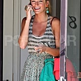Blake carried a hot turquoise bag.