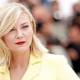 Kirsten Dunst went with a retro and glam sideswept bang, paired with a timeless red lip for a jurors' photocall.