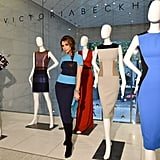 Victoria Beckham posed with dresses from her collection in Vancouver.
