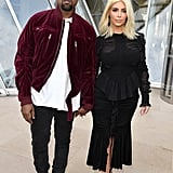 When they walked hand in hand to Louis Vuitton — Kim in couture and Kanye in his sweatshirt.