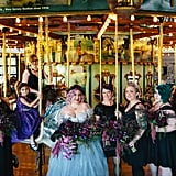 The bridesmaids at this Haunted Mansion-themed wedding wore black lace dresses.