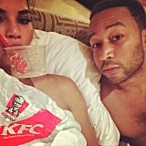 Chrissy shared a photo of the couple eating KFC in bed in November 2014.