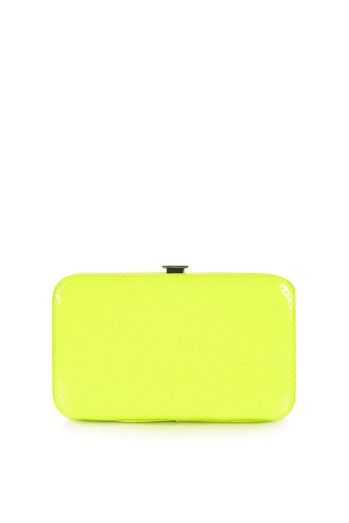 Just try this Topshop neon perforated phone purse ($28) against an LWD for a high-impact contrast.