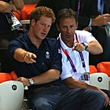 Prince Harry intently watched the swim meet at the Olympics.