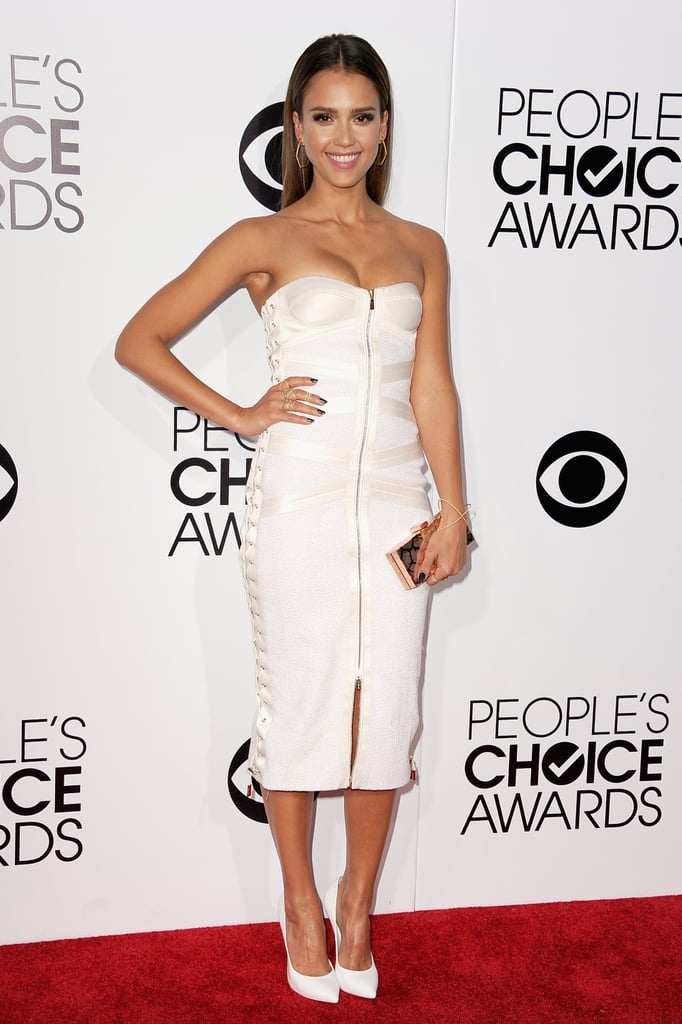 Jessica Alba wowed the audience at the People's Choice Awards in a white Jason Wu dress and Casadei heels on Wednesday night. Jessica shared the stage with Justin Timberlake while presenting the award for favorite album, flashing her wide smile as she handed the singer his Waterford Crystal statue. Jessica attended the show along with dozens of other stars who were both up for awards and just in it for the fun. Her award-show stop comes after she wrapped up a restful family vacation in Mexico over the holidays. The actress celebrated New Year's with her family and friends at the Esperanza Resort and shared plenty of snaps of the fun on Instagram.  Now that the show is wrapped up, make sure to vote on all of our