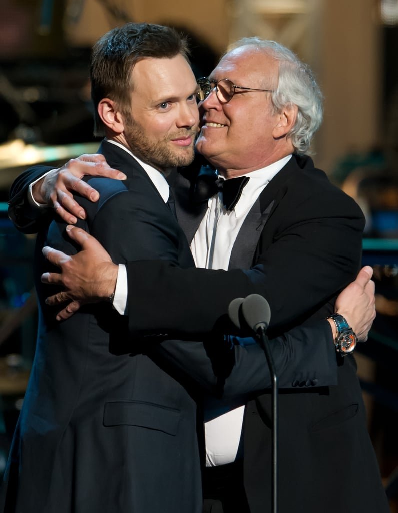 Joel McHale got some love from Chevy Chase at the Comedy Awards in NYC.