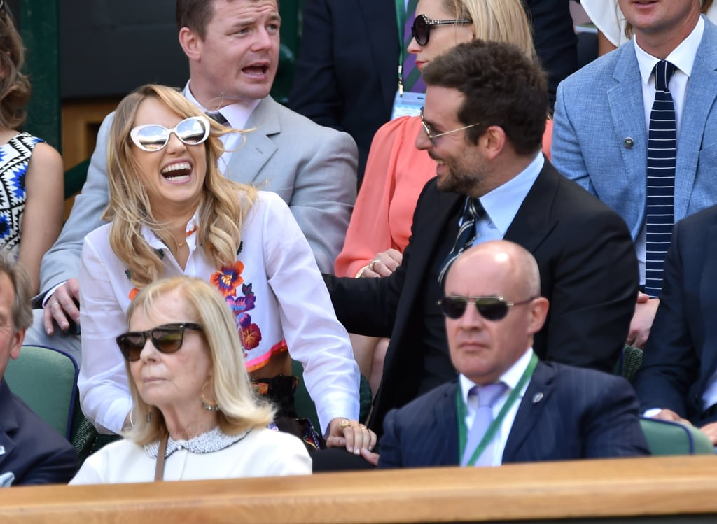 Bradley Cooper and Suki Waterhouse made a stop at Wimbledon on Friday to watch Novak Djokovic face off against Grigor Dimitrov from the royal box. This is hardly the couple's first stop at the famous tennis championships as they visited Wimbledon last year with Bradley's friend Gerard Butler. This time, however, Bradley and Suki passed the time by chatting and joking around with each other as well as adventurer Bear Grylls, who sat next to Bradley. The couple has been spending quite a bit of time together in Suki's home country of England after Bradley wrapped up work on his latest project, American Sniper. Last Tuesday, the duo showed PDA at the annual Serpentine Gallery Summer Party, where they mingled with Pharrell Williams and Keira Knightley. Over the weekend, Bradley hit up the Glastonbury Festival, but Suki wasn't spotted by his side when he checked out Metallica's set.
