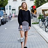 Keep a Dressy Skirt Casual With an Oversize Sweater and Slides