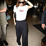 She Styled It With Wide-Leg Trousers and Oversize Sunglasses