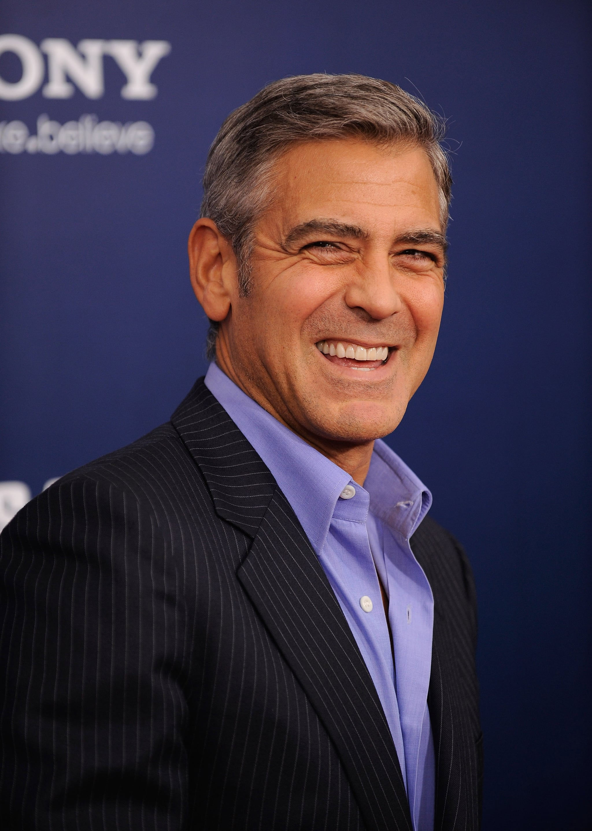 George Clooney couldn't help but smile at The Ides of March premiere in NYC.