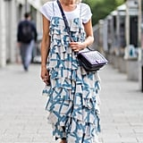 Dress down your most fancy of looks by slipping a classic white tee underneath a printed or layered maxi dress.