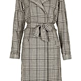 Kate's love for accessible high-street shops isn't likely to change postbaby. We can easily see her in this plaid Topshop trench ($170) on windy days.