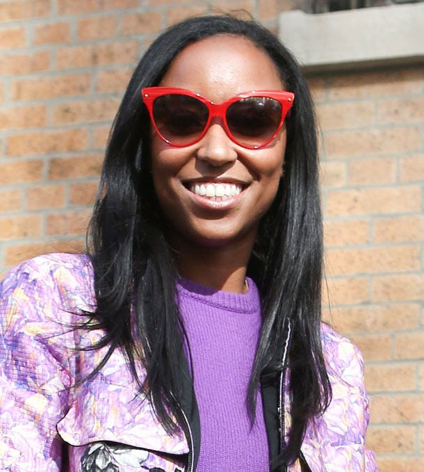 These red shades offset a girlie purple top. Source: Greg Kessler