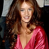 Rosie Huntington-Whiteley sported rich auburn locks and her pink silk robe while getting prepped backstage in 2006.