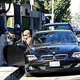 Eric Johnson helps Jessica Simpson into the car.